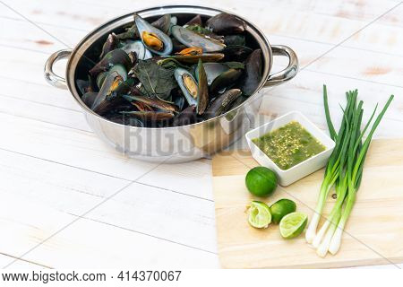 Steamed Mussels And Seafood Sauce On White Table