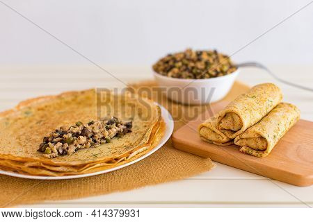 Tasty Thin Pancakes With Fillings. Stuffed Crepes With Minced Chicken Meat Mushrooms And Marinated C