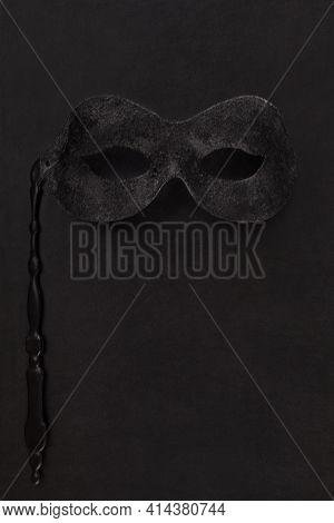 Face Mask On Black Leather Background. Kinky, Bdsm, Roleplay.