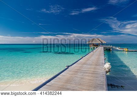 Beautiful Tropical Maldives Resort Hotel And Island With Beach And Sea Horizon, Over Water Villas An