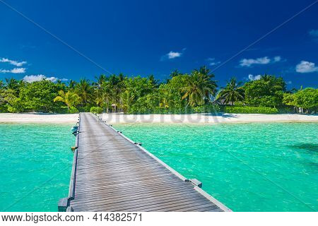 Wooden Pier Jetty Into Tropical Paradise Island, Turquoise Ocean In The Maldives, Indian Ocean. Exot