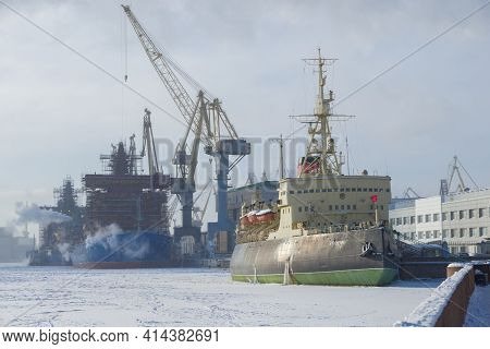 Saint Petersburg, Russia - February 15, 2021: View Of The Old Krasin Icebreaker And New Icebreakers