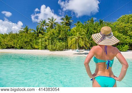 Young Woman In The Blue Lagoon On A Tropical Island. Idyllic Summer Vacation, Beach Landscape, Sunny