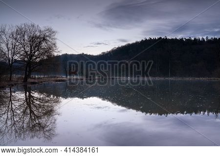 Fishpond Close To Lindlar With Water Reflection During Evening Mood, Bergisches Land, Germany