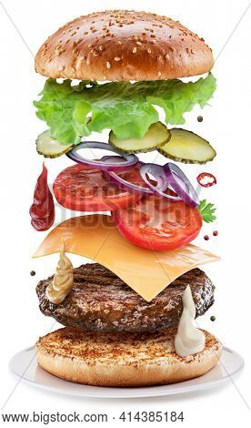 Fast food concept - flying hamburgers ingredients isolated on a white background.