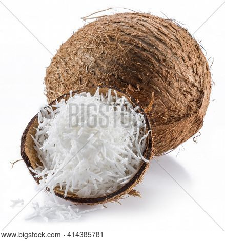 Coconut fruit and shredded coconut flakes isolated on white background.