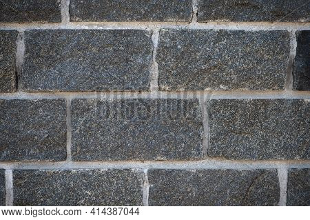 Wall Of Stones. Brick Wall. Gray Background With Black Geometric Patterns. Black Wall Of Rectangular