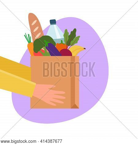 Grocery Delivery Service Concept With Paper Bag Full Of Groceries Products. Hands Hold Paper Grocery