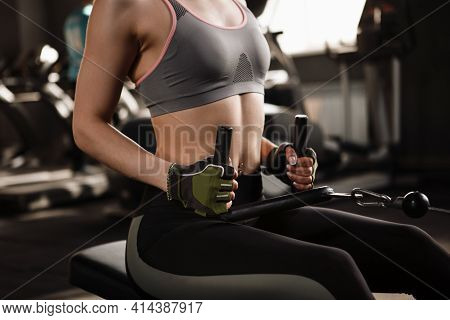 Cropped Shot Of Unrecognizable Sportswoman Working Out On Seated Row Gym Machine