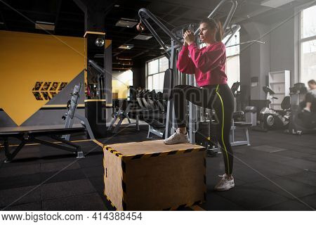Female Athlete Doing Box Step Ups At The Gym, Copy Space