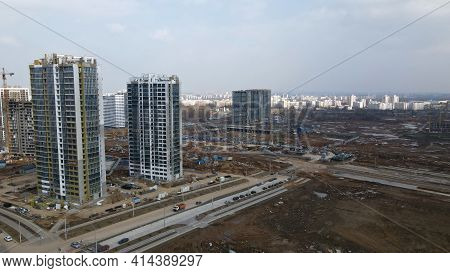 Construction Of A Large Residential Area. The Construction Site Is Visible. Multi-storey Buildings A