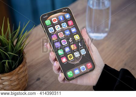 Alanya, Turkey - February 26, 2021: Woman Hand Holding Iphone 12 Pro Max Gold With Home Screen Ios 1