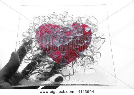 Hand Holding A Broken Glass Heart