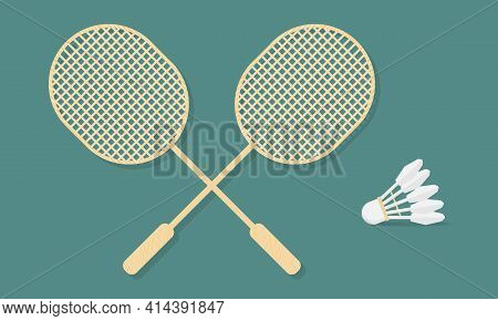 Two Wooden Badminton Rackets And Shuttlecock. Essential Badminton Sport Game Equipment.