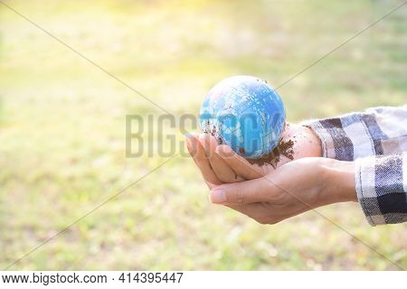 Hand Farmer Holding Earth On Dry Ground Blured. Saving Environment Earth Day, Conservation, Forest D