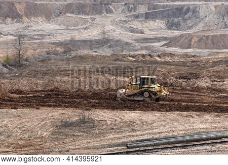 Dozer Has Been Recovering The Landscape Around The Open Pit. Process Of Restoring Land. Bulldozer At