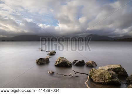 Majestic Landscape Image Of Milarrochy Bay On Loch Lomond In Scottish Highlands With Stunning Winter
