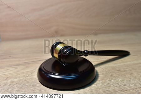Judge Hammer On Wooden Background. Justice Concept In Courtroom. Mallet Of Judge On Law Theme And Le