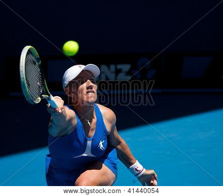 MELBOURNE - JANUARY 23: Svetlana Kuznetsova of Russia in her quarter final loss to Victoria Azarenka of Belarus   at the 2013 Australian Open on January 23, 2013 in Melbourne, Australia.