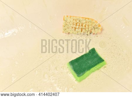 Sponge With Washing Brus And Detergent During Cleaning Bathroom Or Toilet. Washing Dishes And Plumbi