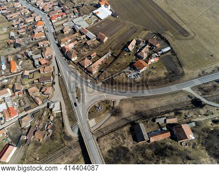 Aerial Drone View, Bridge Over Dirty Olt River , Passing Cars, Small Hungarian Village In Transylvan