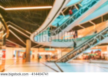Shopping Mall Interior Blurred Background. People Shopping In Modern Commercial Mall Center. Interio