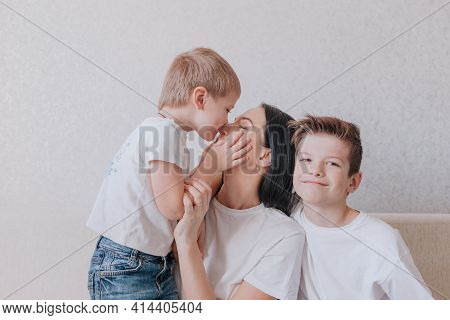 A Little Boy Kisses His Mother On The Nose, Close-up, Family Happiness And Love, Mutual Understandin