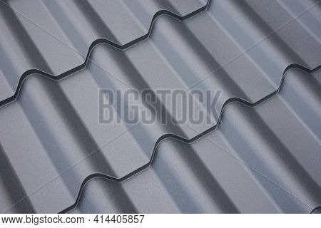 Metal Roof Construction. Background Of Building Materials Close-up.