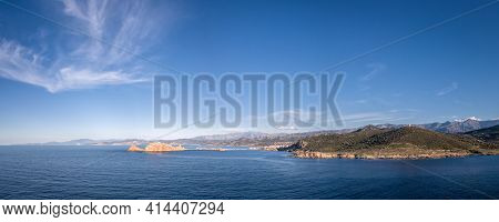 Panoramic Aerial View Of The Red Rock, La Pietra, At Ile Rousse And The Rugged Coastline Of The Bala