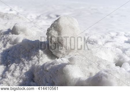Snowball In A Snowdrift On A Winter Sunny Day. Winter Background.