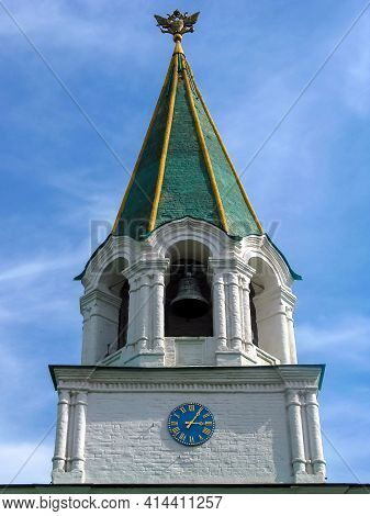 View From Below Of The Ancient Tower With Bell Tower And Clock Of Old Orthodox White Stone Church In