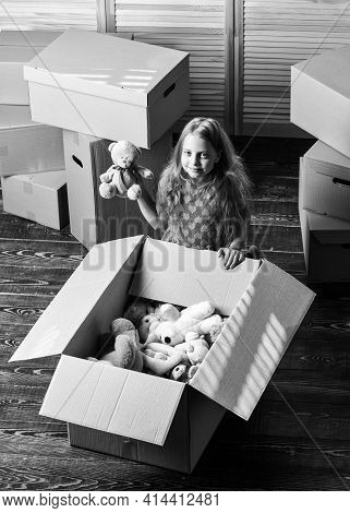 Box Package And Storage. Small Child Prepare Toys For Relocation. Kid Girl Relocating Boxes Backgrou