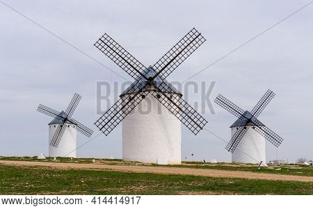Three Whitewashed Traditional Spanish Windmills On The Plains Of La Mancha