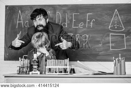 Back To Class Is Cool. Using Microscope In Lab. Back To School. Teacher Man With Little Boy. School