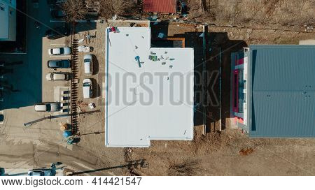 Aerial View Of An Apartment Building With Flat Roof In Construction, Ballasted System With Geotextil