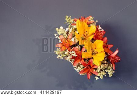 Beautiful Bouquet Of Orange And Yellow Lilies And White Hydrangea Flowers On Gray Background. Top Vi