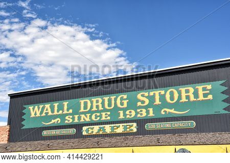 WALL, SOUTH DAKOTA - 22 JUNE 2017: Hustead's Wall Drug Store sign closeup. The tourist attraction is a favorite stop for travelers along Interstate 90.