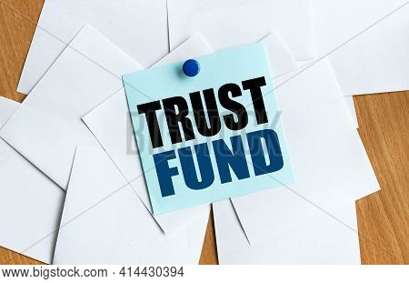 Trust Fund. Text On Blue Sticker On Table Button Holds Sticker