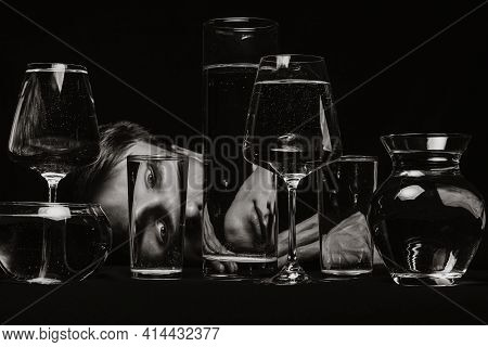Surreal Portrait Of A Strange Man Looking Through Glasses Of Water