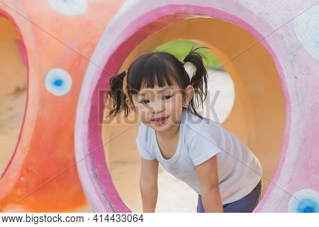 Portrait Image Of 2-3 Years Old Of Toddler Baby Girl. Happy Asian Child Playing With The Toy At The