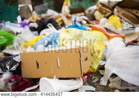 A Pile Of Garbage In A Landfill And An Abundance Of Waste, Trash And Pollution Of Plastic Bottles An