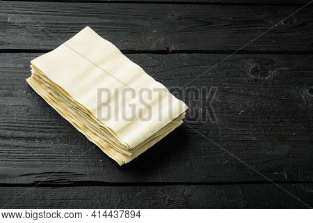 Lasagna Dough Sheets Set, On Black Wooden Table Background, With Copy Space For Text
