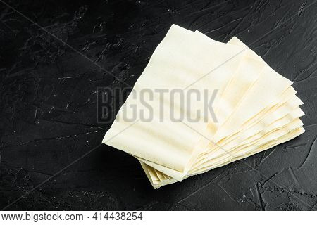 Organic Lasagna Pasta Sheets Set, On Black Stone Background, With Copy Space For Text