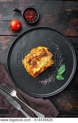 Classic Meat Lasagna With Cheese Bechamel And Bolognese Sauce Set, On Plate, On Old Dark  Wooden Tab