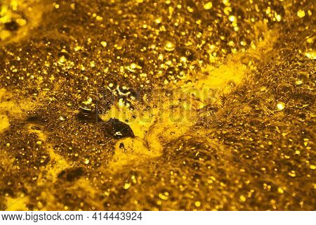 Boiling Gold. Foam Texture As Background. Background And Texture Concept. Close Up Of Bubbling Golde