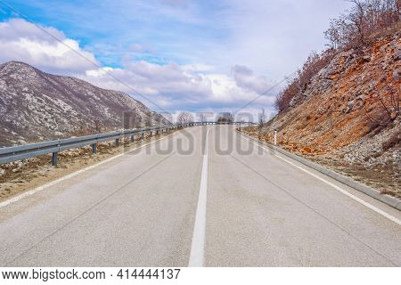 Balkan Road Trip.  Mountain Landscape With Road In Dinaric Alps. Asphalted Two-lane Road With Contin