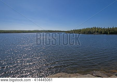 Afteroon Sparkles On A Wilderness Lake On Ogishkemuncie Lake In The Boundary Waters In Minnesota