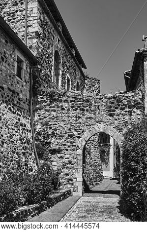 A Medieval Gate In A Stone, Historic Buildings In The City Of Saint-vincent In France, Monochrome