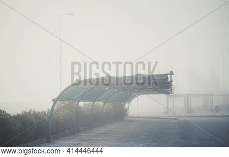 View Of An Empty Foggy Covered Car Parking On A Territory Of A Typical Gas Station Zone Of Portugal;