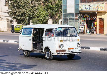 Giza, Egypt - January 26, 2021: Urban Minibus Volkswagen Kombi T2 In The City Street.